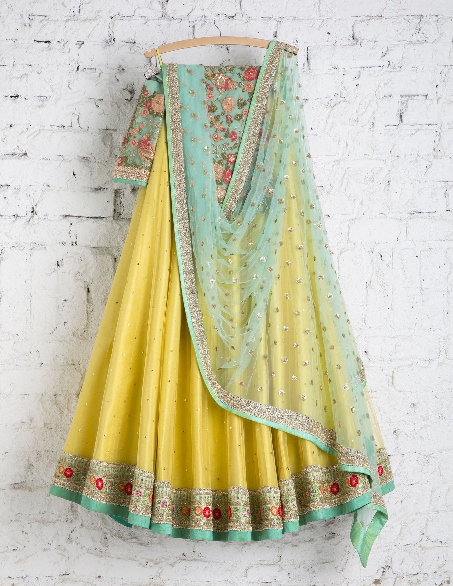 Fancy Yellow Colored Party Wear Embroidered Net Lahenga