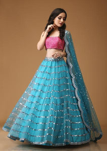 BLUE CHANDLIER FIROZI CHANDLIER LEHENGA WITH FUSCHIA SEQUINED BLOUSE- NV-003