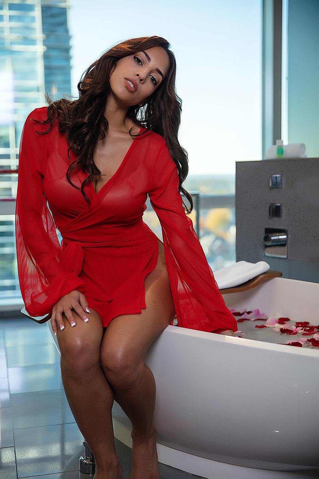 beautiful girl in red lingerie robe in modern urban bathroom