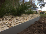 Core Edge Flexible Steel Lawn Edging shown in Light Grey as border of flower bed - Edge It Co by Henderson Supply