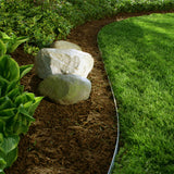 Core Edge Flexible Steel Lawn Edging show in Galvanized used as a border between yard and garden - Edge It Co by Henderson Supply