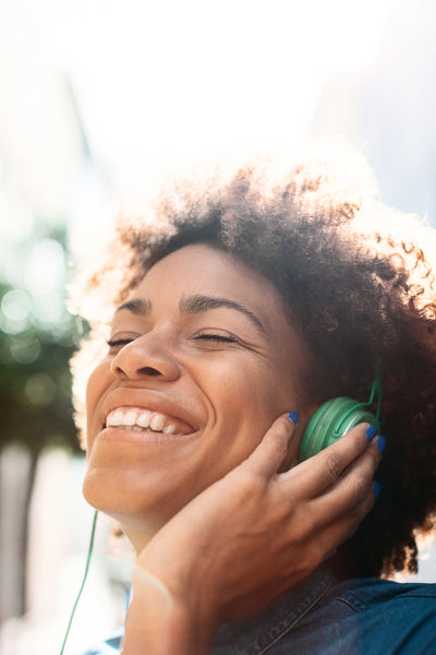 These 13 Feel-Good Podcasts Will Bring Joy to Your Day