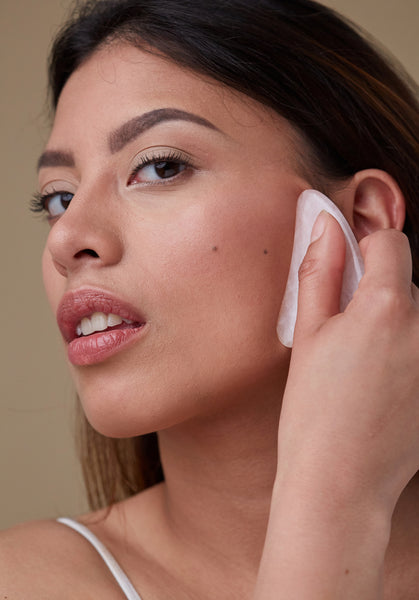 Gua Sha: The Facial Treatment You Can DIY At Home