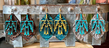 Load image into Gallery viewer, Thunderbird earrings {blue and mustard}