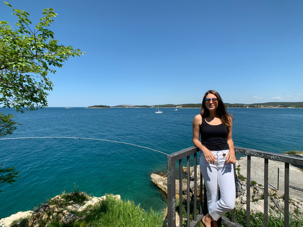 Woman standing by Adriatic Sea in Rovinj, Croatia