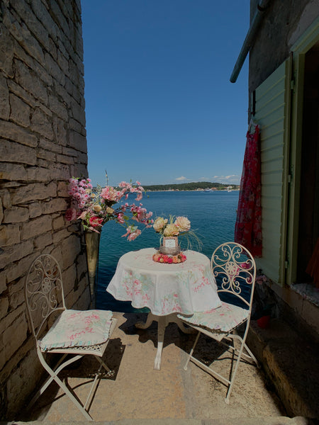 Table and chairs in narrow stairway in Rovinj, Croatia
