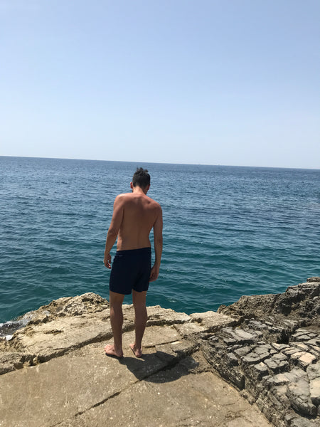 Man in Copper Bottom Swim shorts at Cape Kamenjak, Croatia