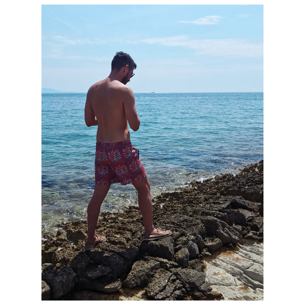 Man in Copper Bottom Swim trunks standing near water at Cape Kamenjak, Croatia