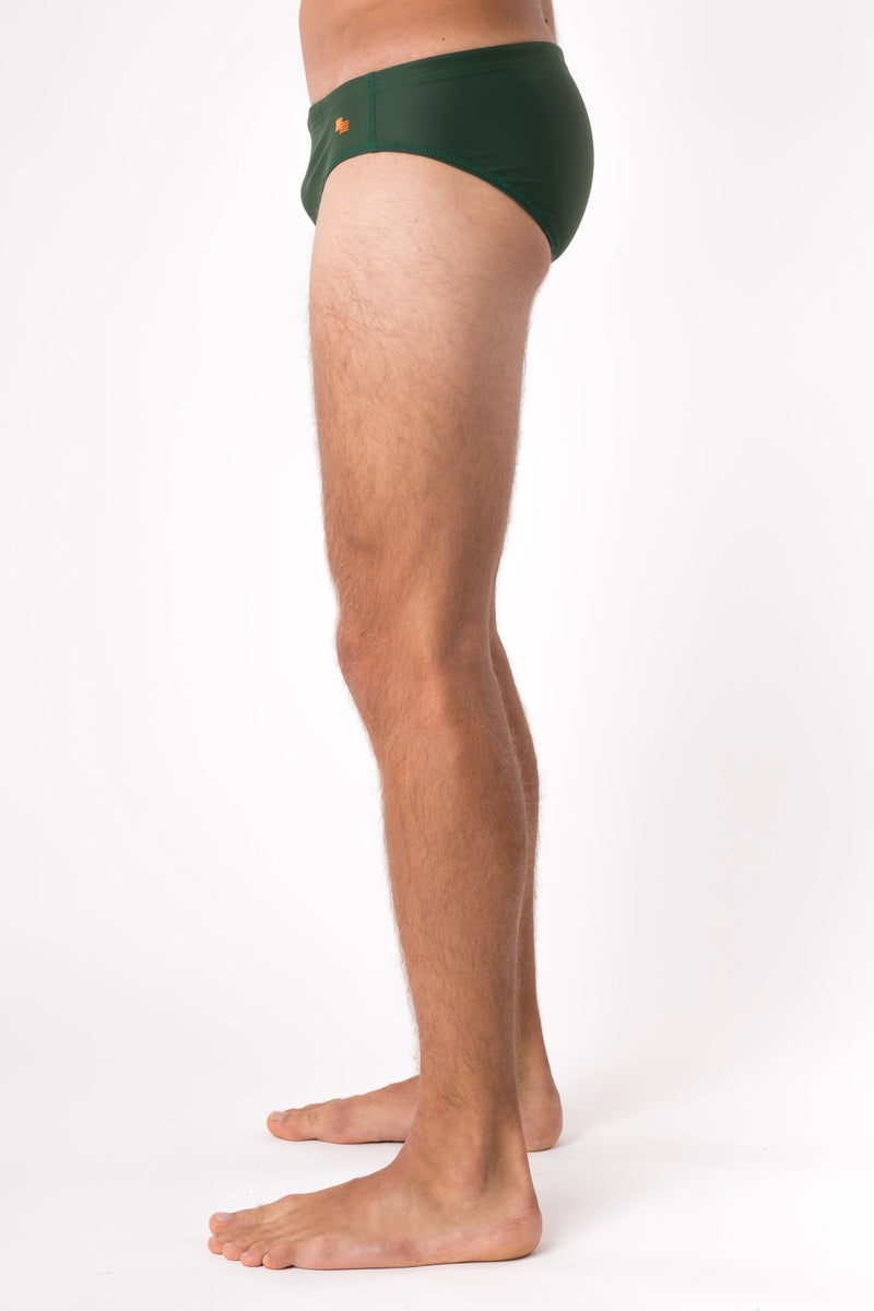 Man in dark green swimsuit - Copper Bottom Swim