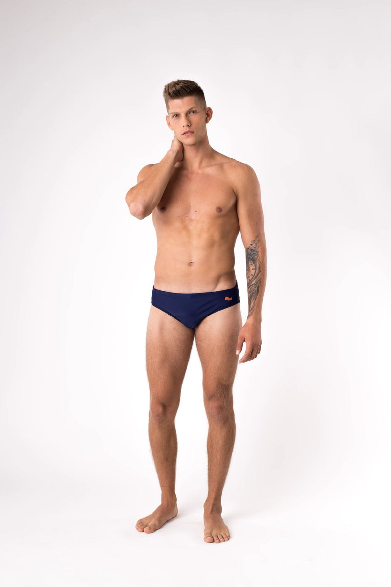 Tall man modelling navy blue swim brief - Copper Bottom Swim