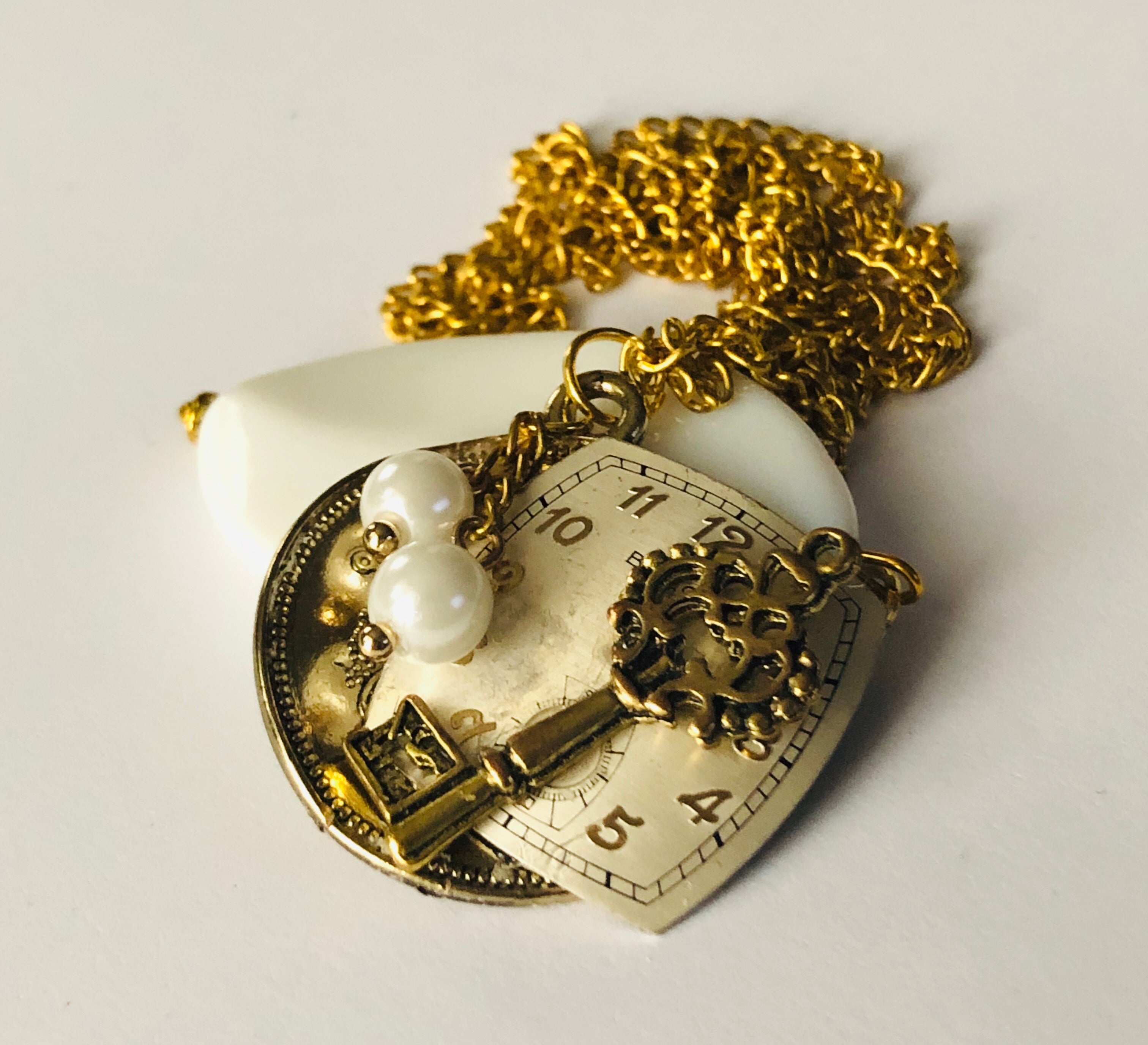 Unlock the Gates of Time Gold Pendant Necklace