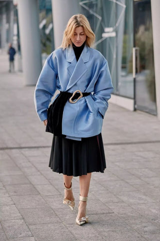 exaggerated belt tied outside the coat