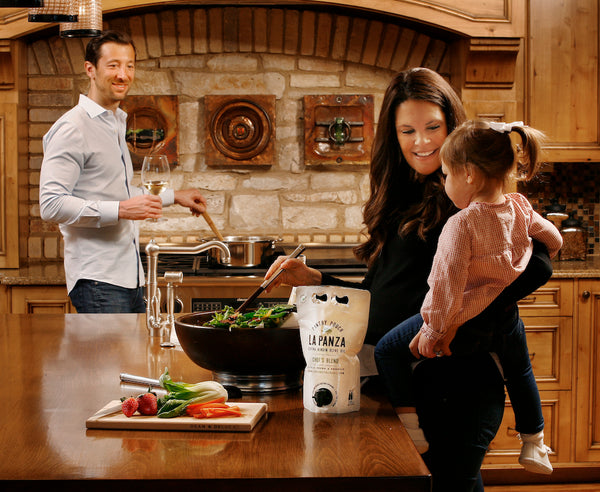 Father, mother, and daughter cooking with La Panza Fresh Olive Oil