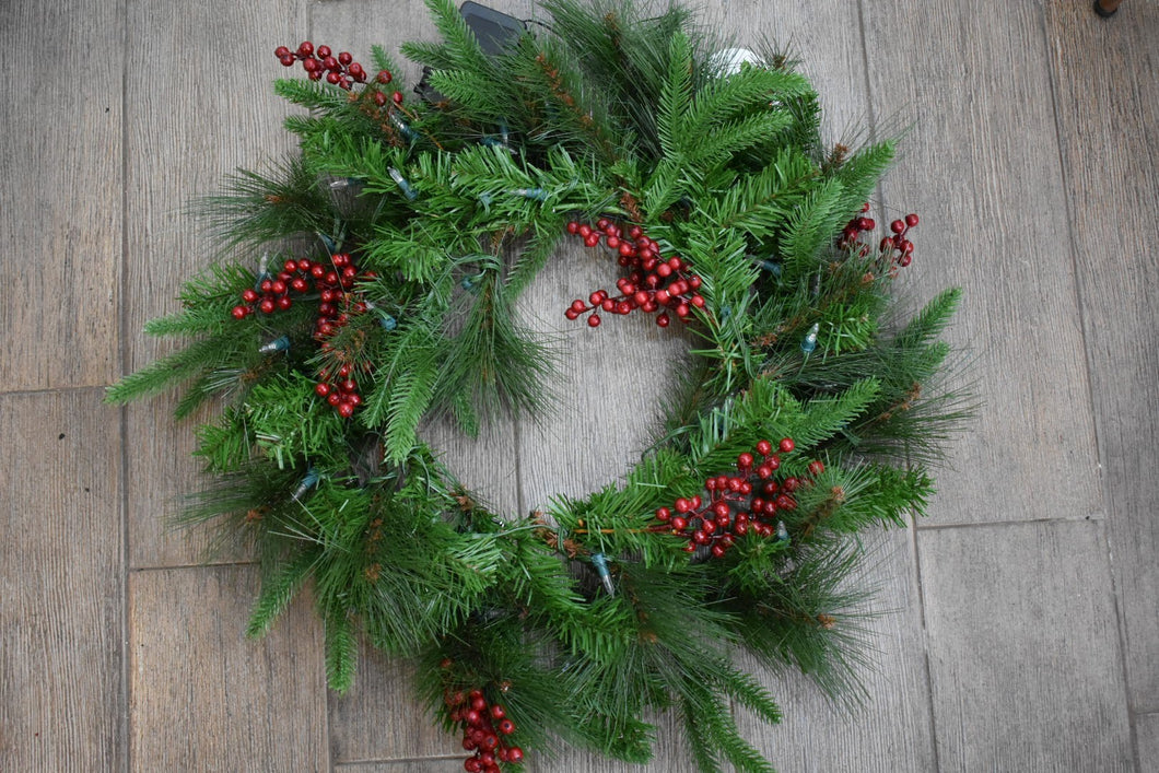 A beautiful decorative wreath with red berries