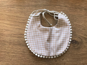 Brown reversible bib