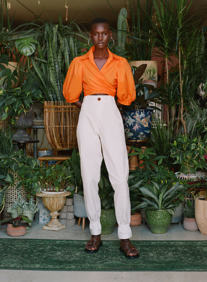 Petersyn-Cellini-Orange Stretch-Top-Spring 20- Above the Keyboard Dressing- Orange Wrap Top- Puff Sleeve- Destination Dressing- Resort Top