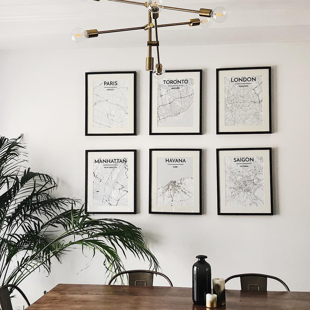 Mix of City Map Prints on Wall