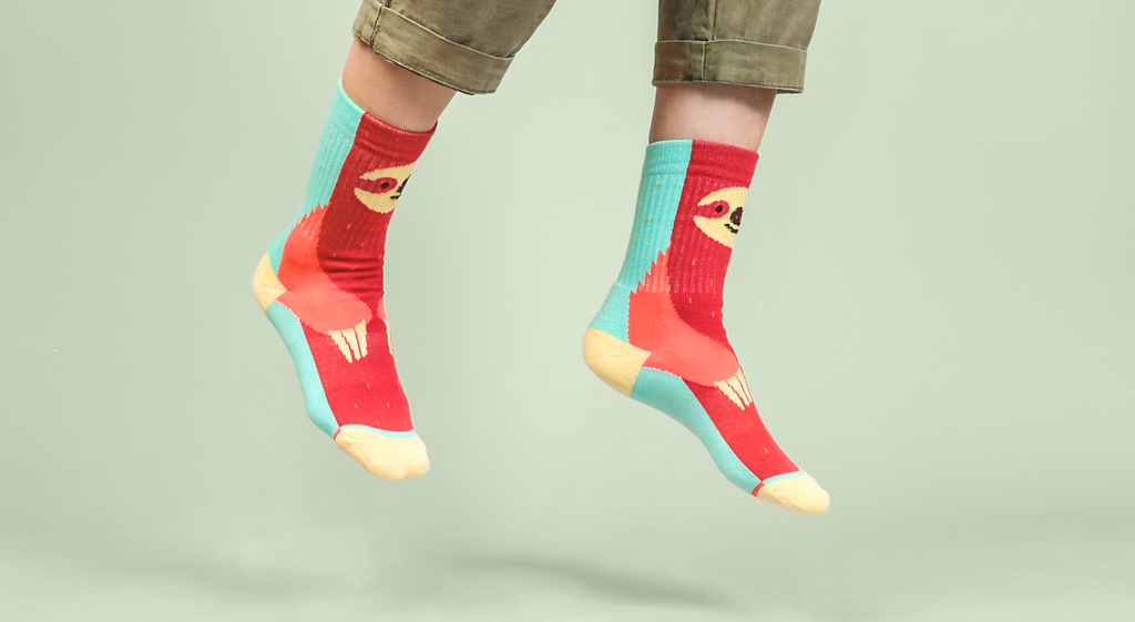sloth socks with red front and mint back to represent algae growing on sloth's back because they slow