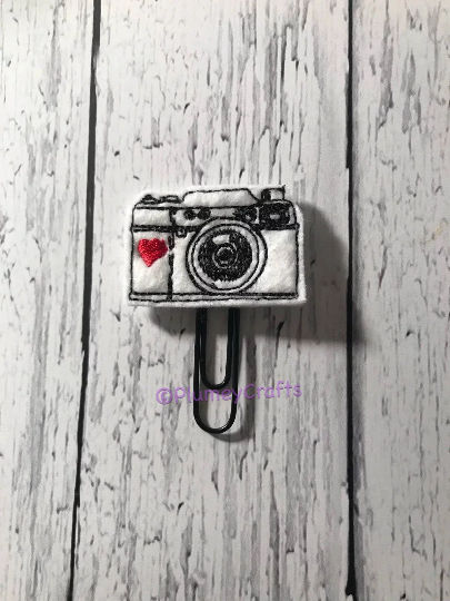 Camera on Black Paper Clip