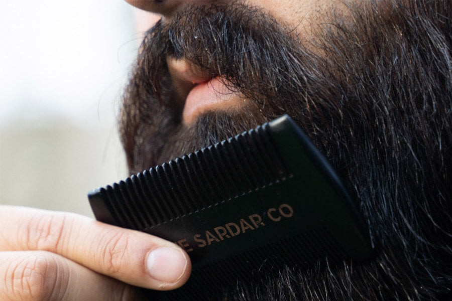 beard comb gliding through beard