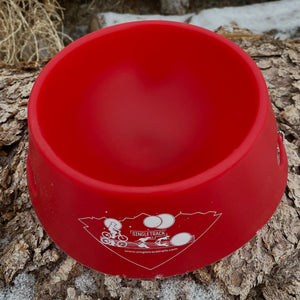 silipint ricochet red foldable dog bowl interior on log