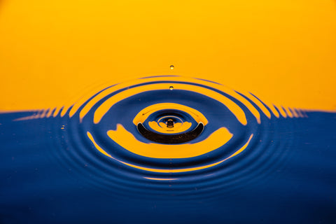 Water drop in a blue and orange background