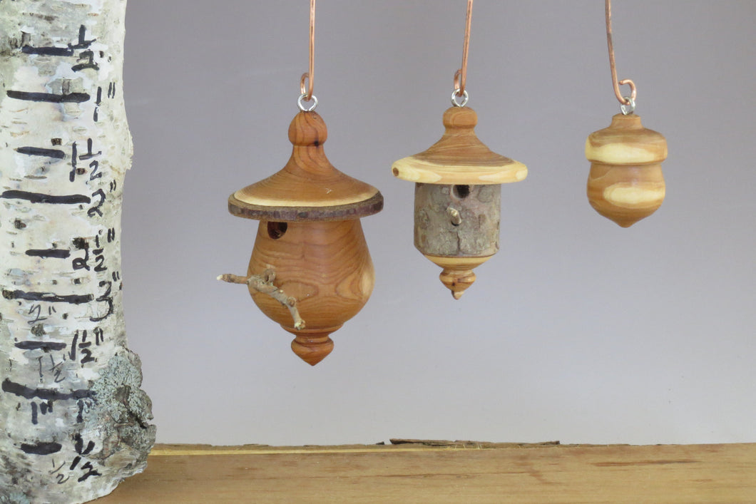 turned wood ornaments, birdhouses, yew acorn, small copper hooks