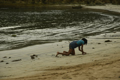 child plays in the beach