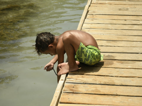 kid in pier in puerto rico beach