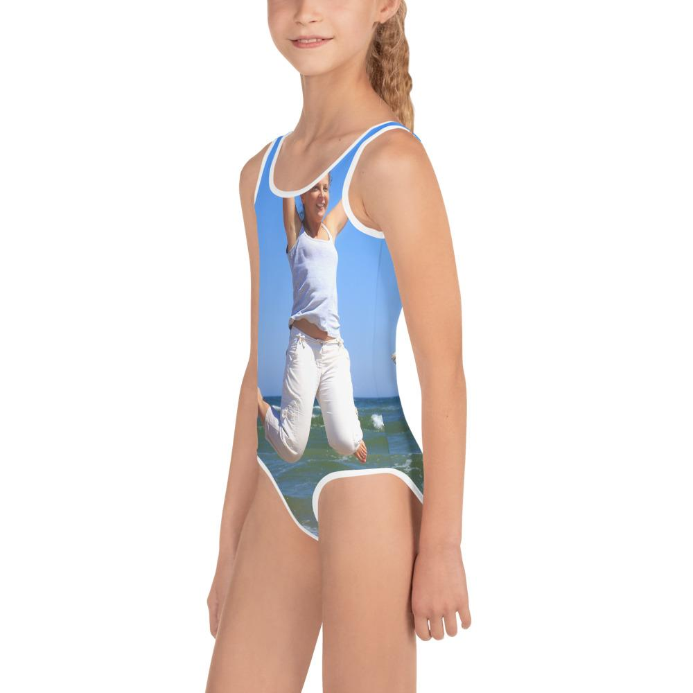 All-Over Print Kids Swimsuit - Girl Jumps with dog on beach - Yunque Store