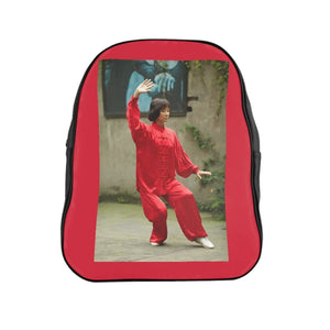 GREAT CHINA COLLECTION: School Backpack - Made in China by Artsadd - Chinese woman play a kind of traditional Chinese shadowboxing (tai chi chuan) in Chong Qing, China - Yunque Store