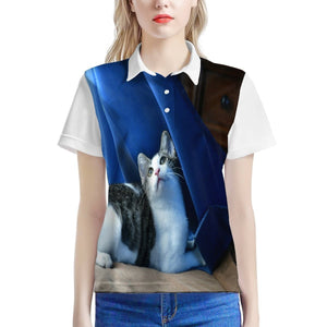 Women's All Over Print Polo Shirt - The baby cat Dante dazzled by the curtains, wind and light - Isabela PR - Yunque Store