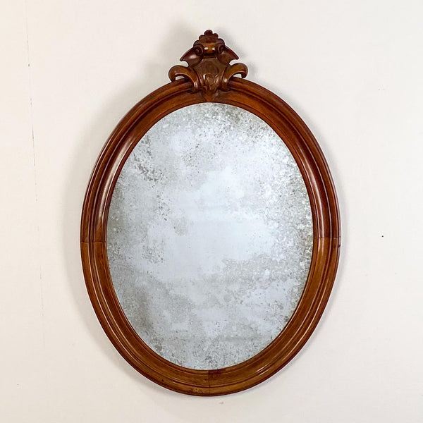 Oval Mirror with a Crest, American 19th Century
