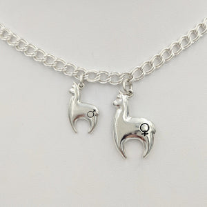 Alpaca Huacaya hand-made Sterling silver crescent shaped charms with a gender accent stamp.  2 sizes available; shiny finish