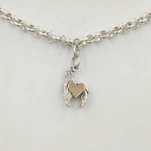 Sterling silver crescent charm with 14K rose gold heart accent.