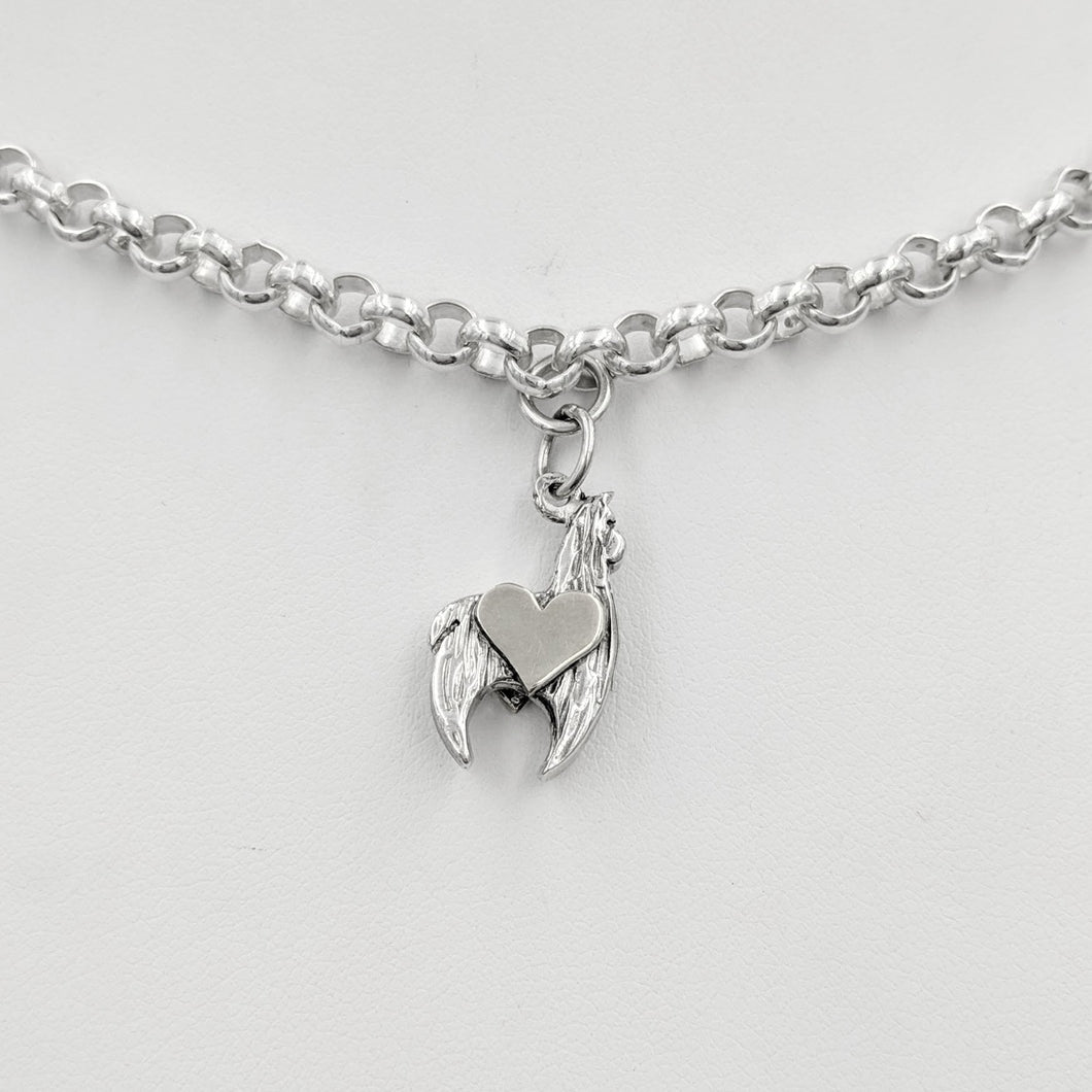 Sterling silver crescent charm with sterling silver heart accent.