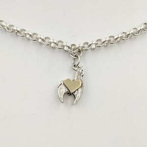 Sterling silver crescent charm with 14K yellow gold heart accent.
