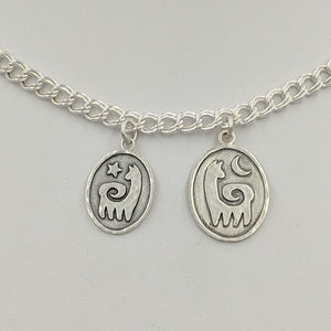2 sizes of Alpaca or Llama Reflection Petrogylph Charms - with Star and Moon Hammered Rim  Sterling Silver