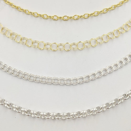 4 Styles of Charm Bracelets - 14K Yellow Gold Modern Simple Link and Traditional Charm Bracelet and Sterling Silver Traditional Charm Bracelet and Modern Rolo Link
