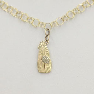 View from behind - 14K Yellow Gold  Swoosh Tush Alpaca Huacaya Charm  with 14K White Gold tail