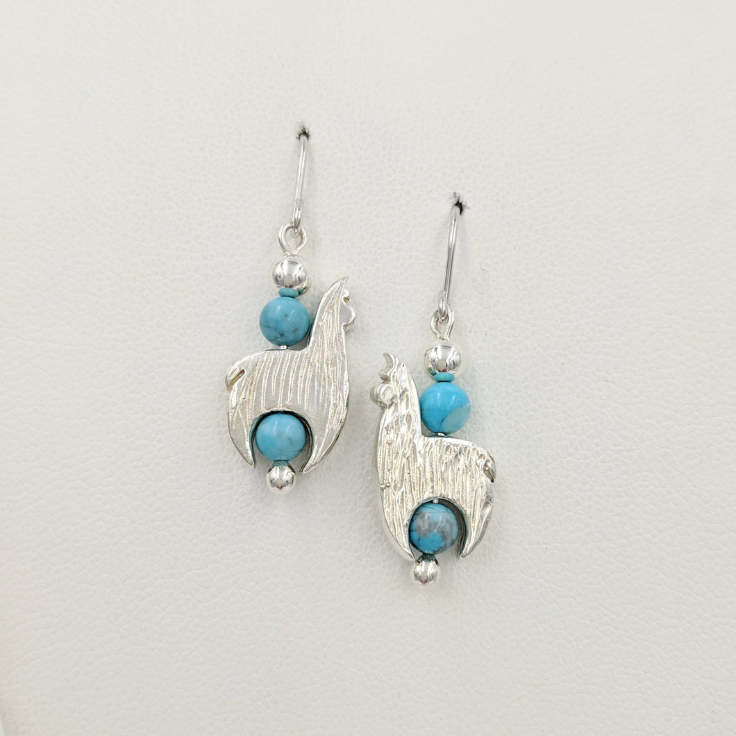 Alpaca Huacaya Crescent Earrings With Turquoise Beads & Fiber Finish; hanging on French wires.