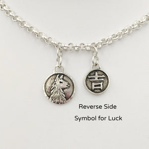 Llama Luck Reversible Charms showing both sides -the Llama head and the Good Luck symbol Sterling Silver