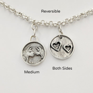 Llama  Momma Baby Cria Kiss Charm - Reversible Charm; medium size.  Mother and baby on one side; 2 hearts on the reverse.  Sterling Silver