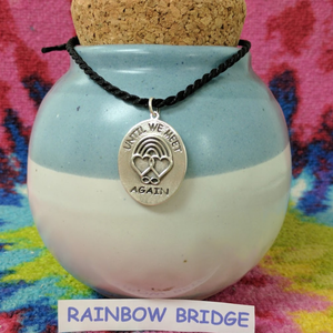 Rainbow Bridge Ovals Discs  Front Side Sterling Silver Shown on memorial urn