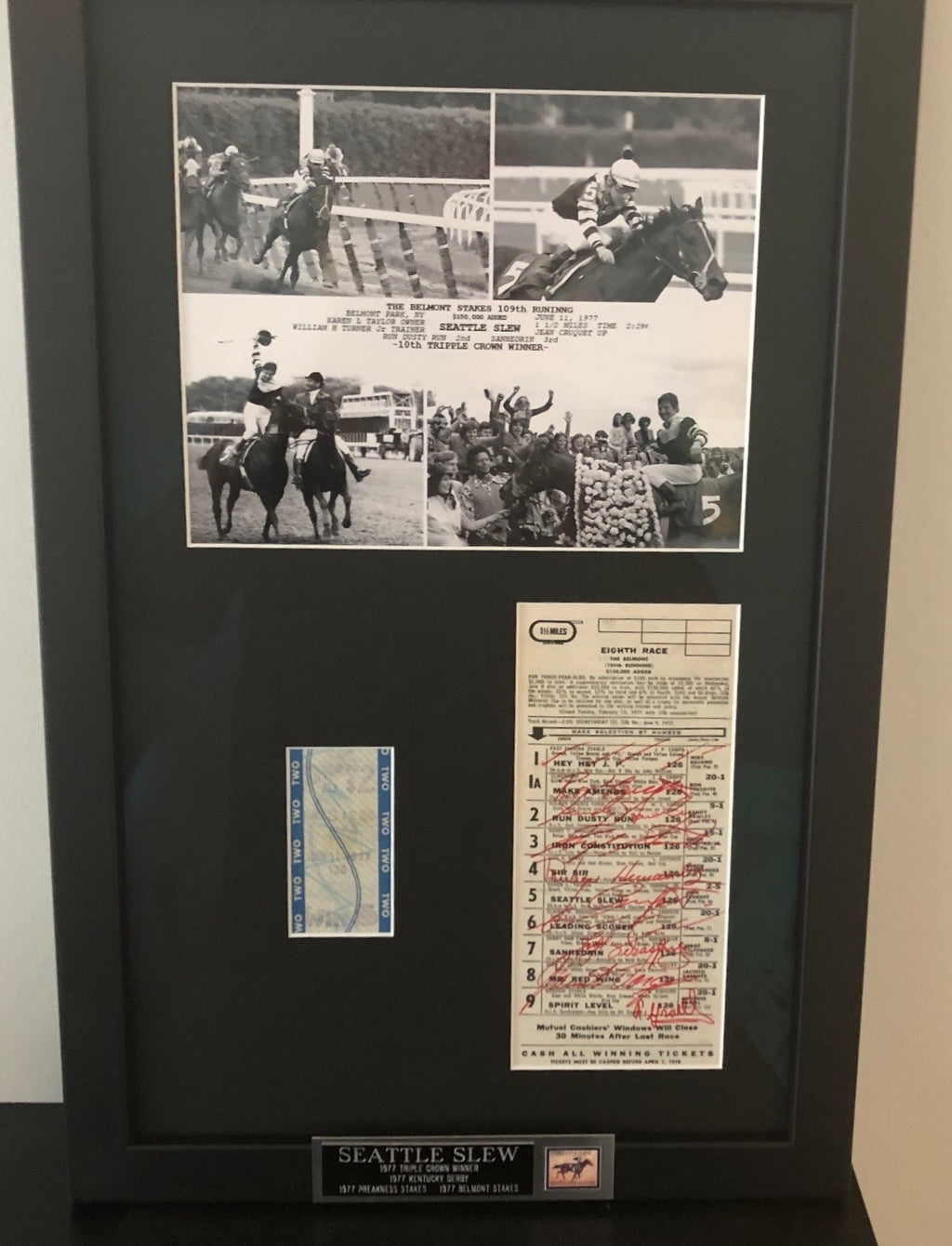 SEATTLE SLEW 1977 TRIPLE CROWN UNCASHED TICKET, AUTOGRAPHED PROGRAM AND FINISH LINE PHOTO IN A PROFESSIONAL CUSTOM MADE FRAME