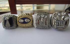 NEW YORK GIANTS FOUR RING SUPERBOWL SET WITH DISPLAY CASE