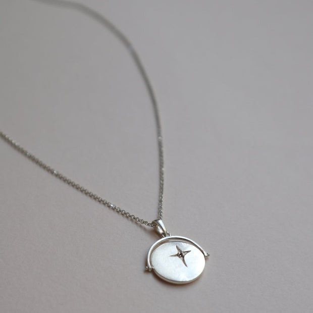 silver spinner necklace