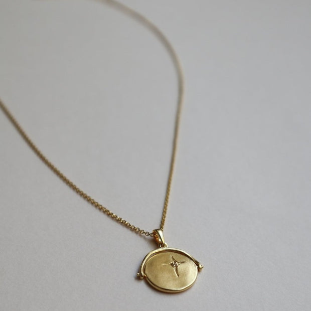gold spinner necklace