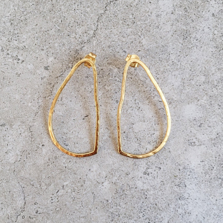 oval drop earring gold lines and current