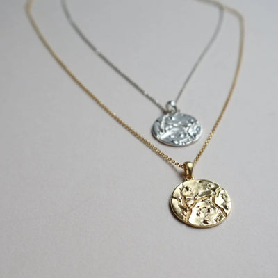 cosmo coin necklace lines and current